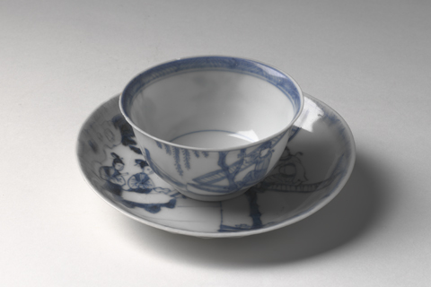A tea bowl and saucer.