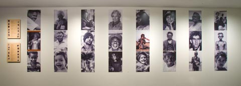 Portrait wall featuring photographs representing the many faces of the First Australians