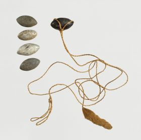 Sling made of two twisted plant fibre strings about 2mm thick with a tufted end. The sling stones, from steatite, have the shape of a symmetrical egg.