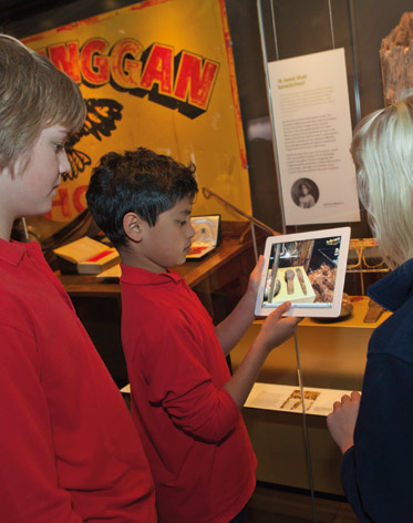 A colour image of students playing a game on an iPad.