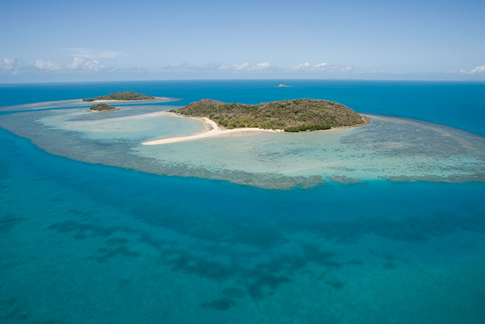 An aerial photograph of Tuesday Islets, near Ngurapai (Horn Island) in the Torres Strait.