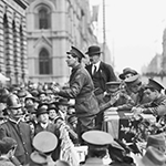 A black and white photo of spectators at the 1917 conscription referendum campaign in Collins Street, Melbourne.