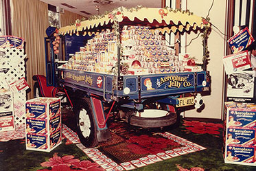 Rear view of a truck's tray, loaded with packets of jelly crystals.