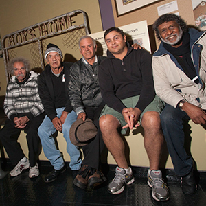 Stolen Generations members Cecil Bowden, Manuel Ebsworth and Michael Welsh, accompanied by Jason Pitt and Pastor Ray Minniecon, in front of the gate from Kinchela Boys Home, at the National Museum of Australia