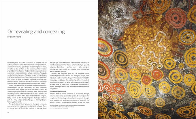 Songlines catalogue spread with text 'On revealing and concealing by Diana Young' and Seven Sisters rock art painting