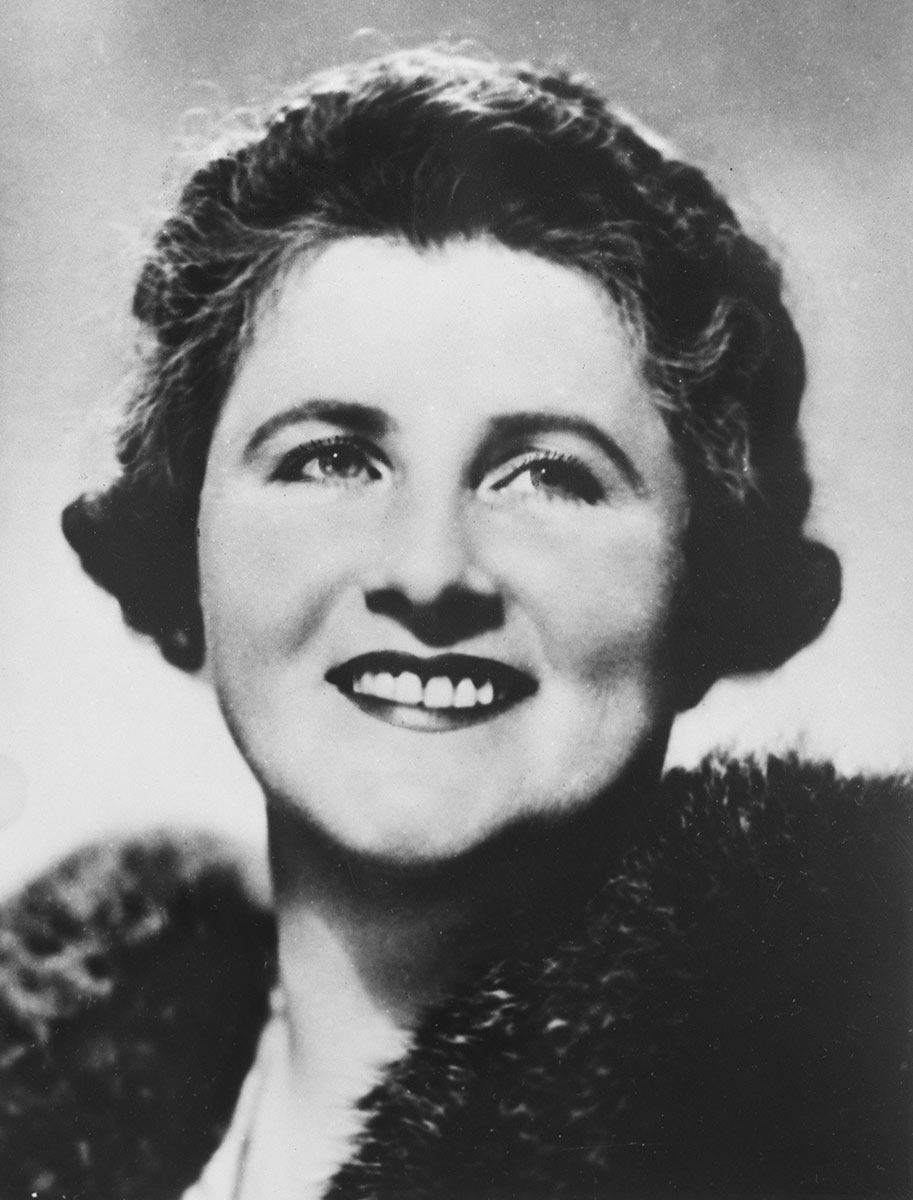 Black and white photo of Dame Enid smiling. - click to view larger image