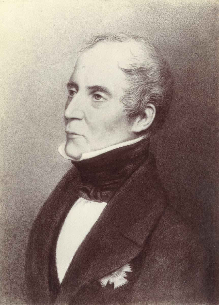 Three quarter profile black and white image of a middle-aged man in formal wear with a black cravat and black coat. The man's expression is serious, even severe. - click to view larger image