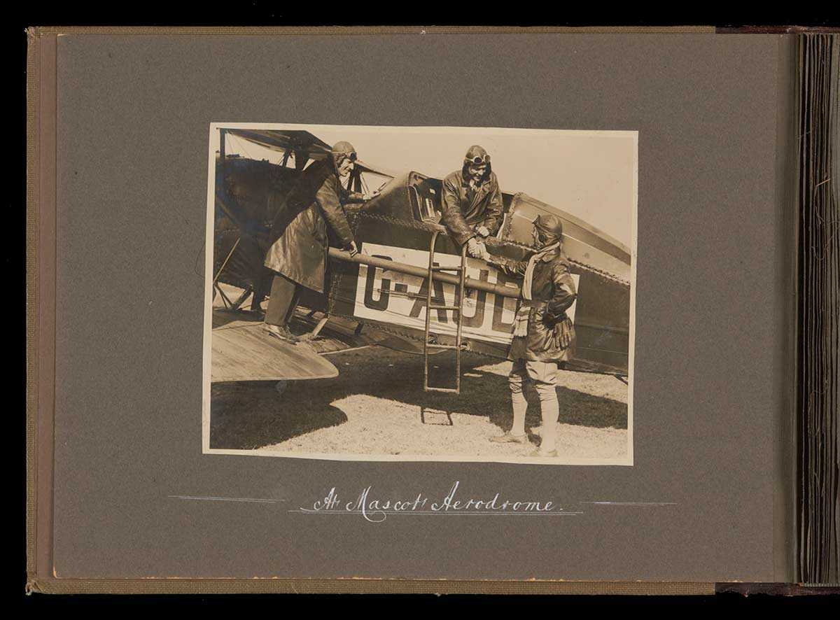 Kingsford Smith, Ulm and a third man with the aviators' biplane - click to view larger image