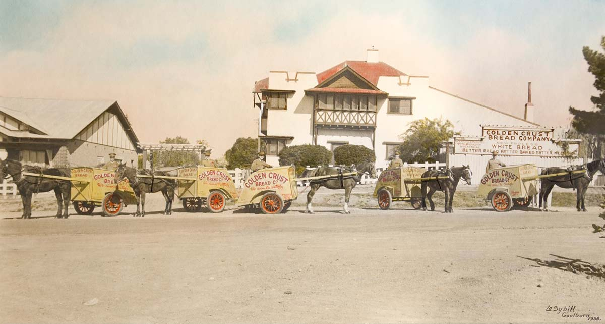 Painting of delivery carts drawn by horses standing outside the Golden Crust Bakery in Goulburn, 1938. - click to view larger image