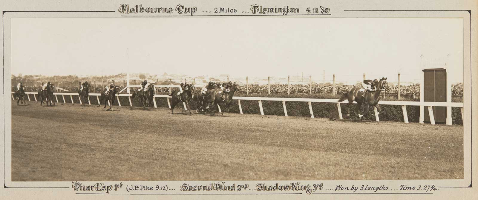 A black and white photo of Phar Lap winning the Melbourne Cup, 1930. - click to view larger image