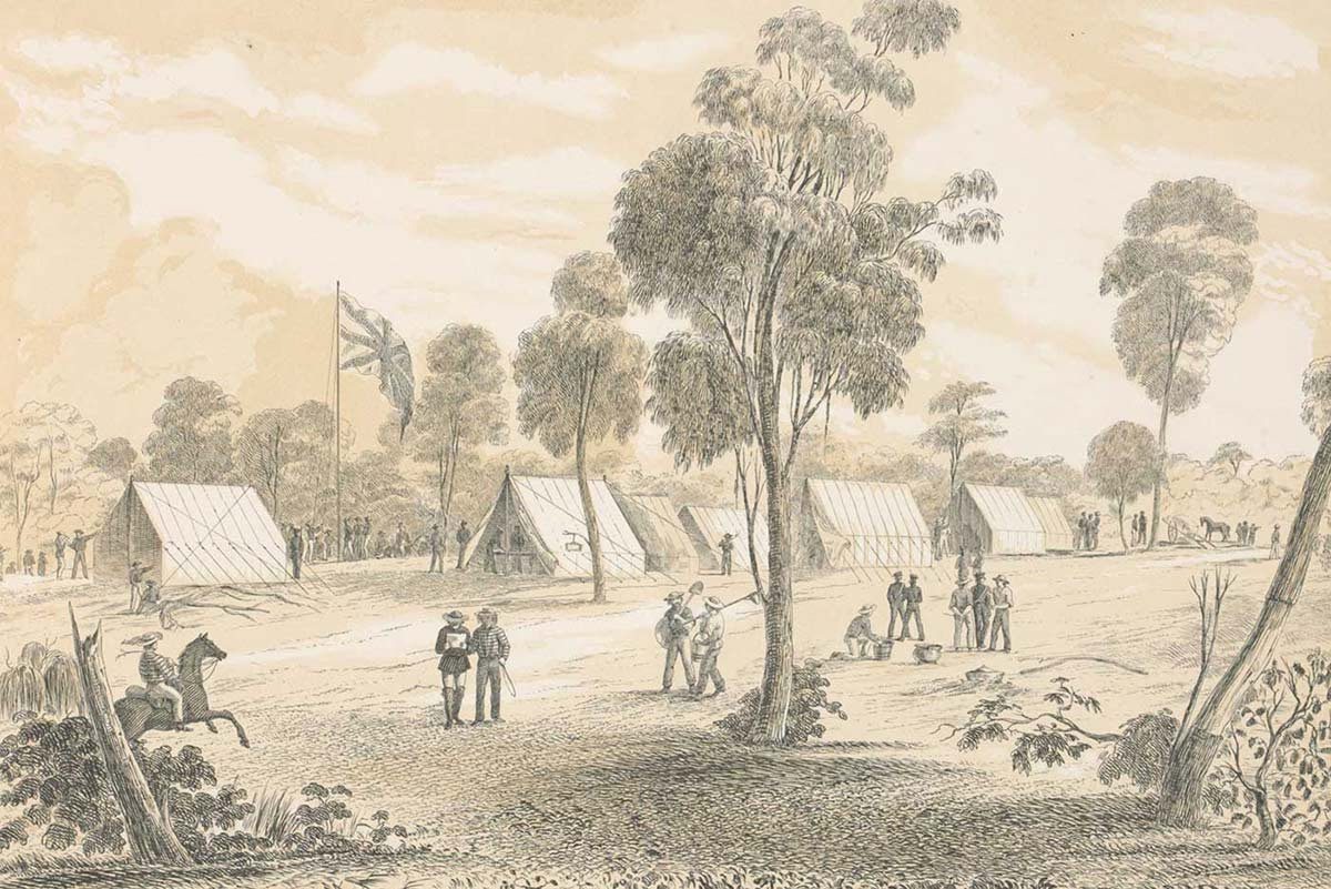 Black and white illustration showing a landscape view of a seven tents erected near a large British flag, flying among gum trees. Several men are gathered in small groups and another rides a horse. - click to view larger image