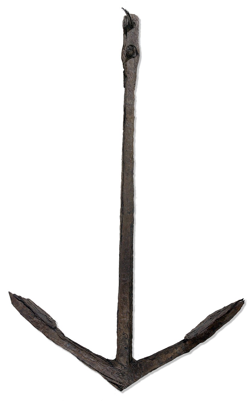 A large anchor, dark brown in colour, and rusted in appearance. - click to view larger image