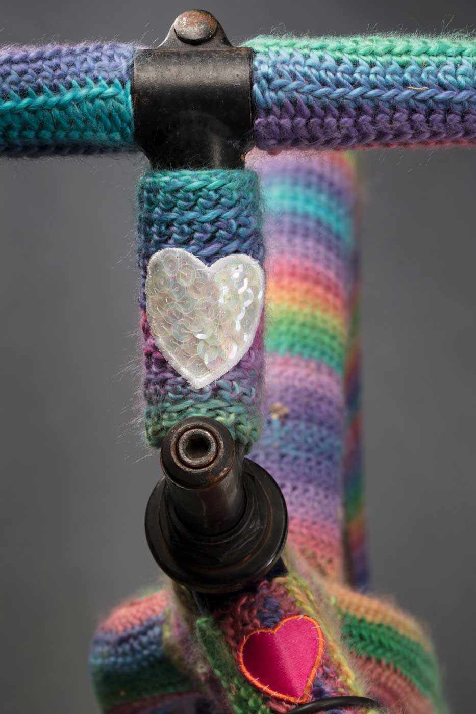 Bike handlebars covered in rainbow-coloured wool - click to view larger image