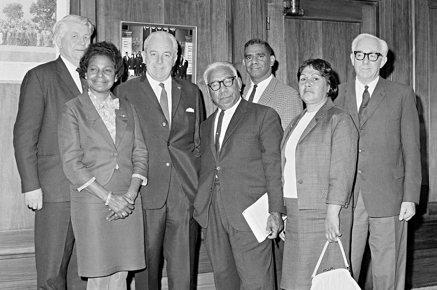 Black and white photo of Gordon Bryant MHR, Faith Bandler, Prime Minister Harold Holt, Pastor Doug Nicholls, Harry Penrith, Winnie Branson and William Wentworth, MHR.