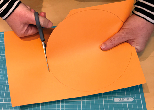 hands cutting paper