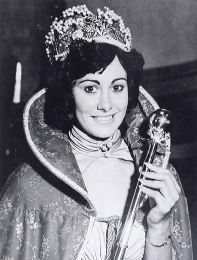 Miss Australia 1977, Francene Maras holding the sceptre, wearing the crown and a long flowered cape - click to view larger image