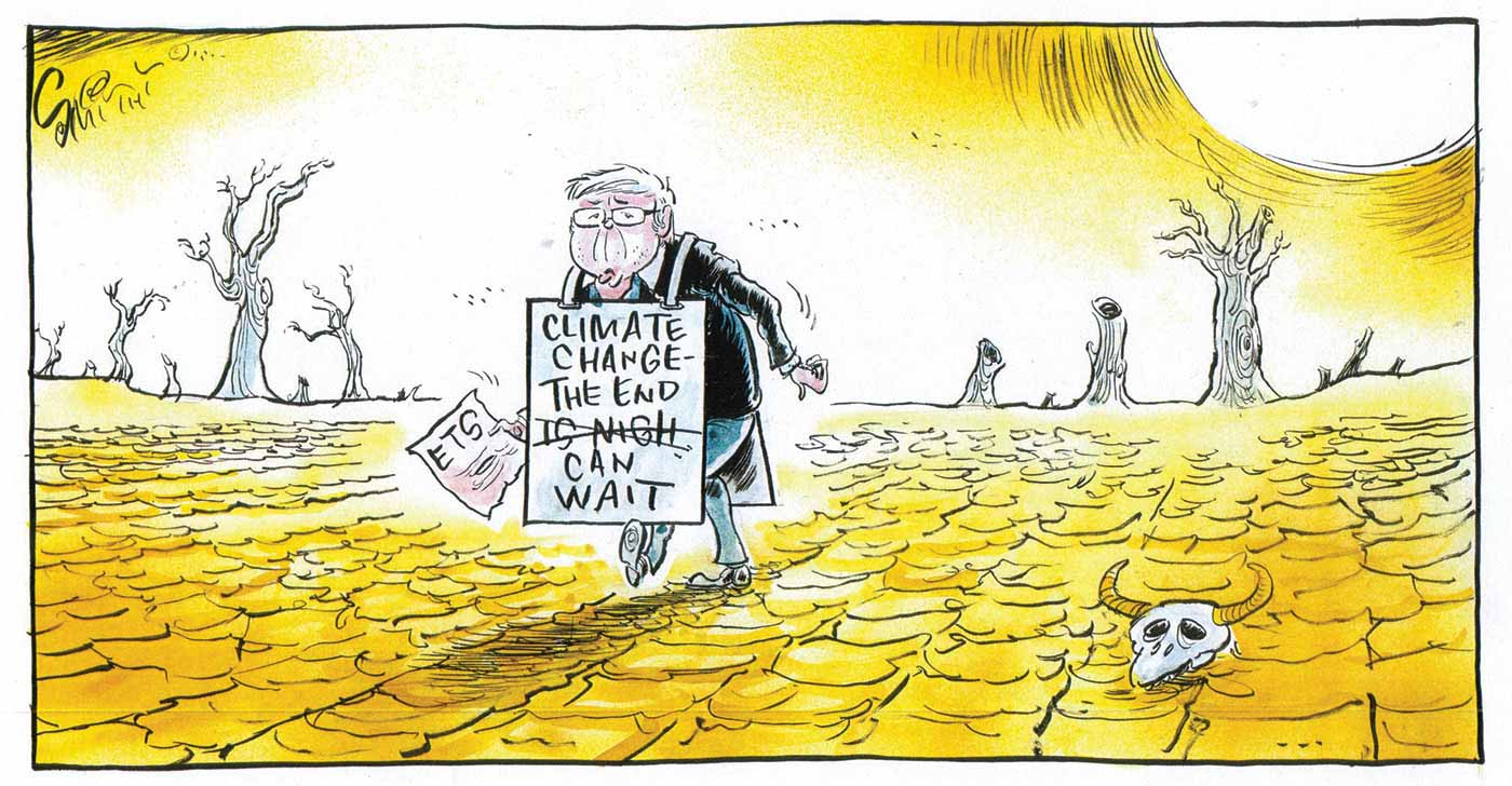 A colour cartoon depicting Kevin Rudd wandering through a hot desert landscape, with dead tree stumps in the background, and a cattle skull in the foreground. Mr Rudd carries a document headed 'ETS' and over his shoulders he wears a placard which says, 'Climate change – the end is nigh'. 'Is nigh' has been crossed out and replaced with 'can wait'.  - click to view larger image