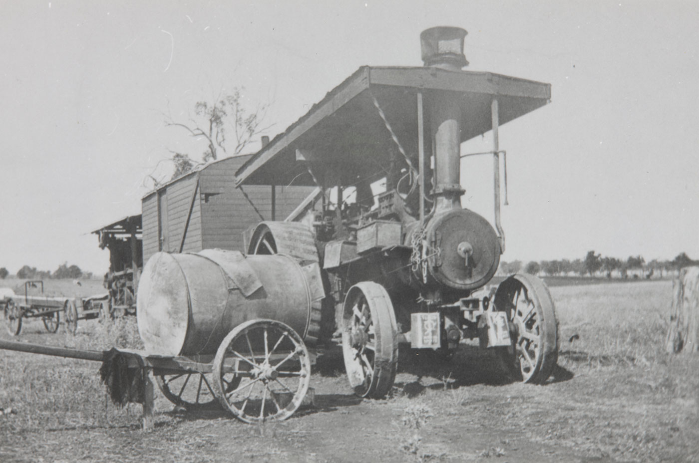 Steam-powered vehicle in a field. - click to view larger image