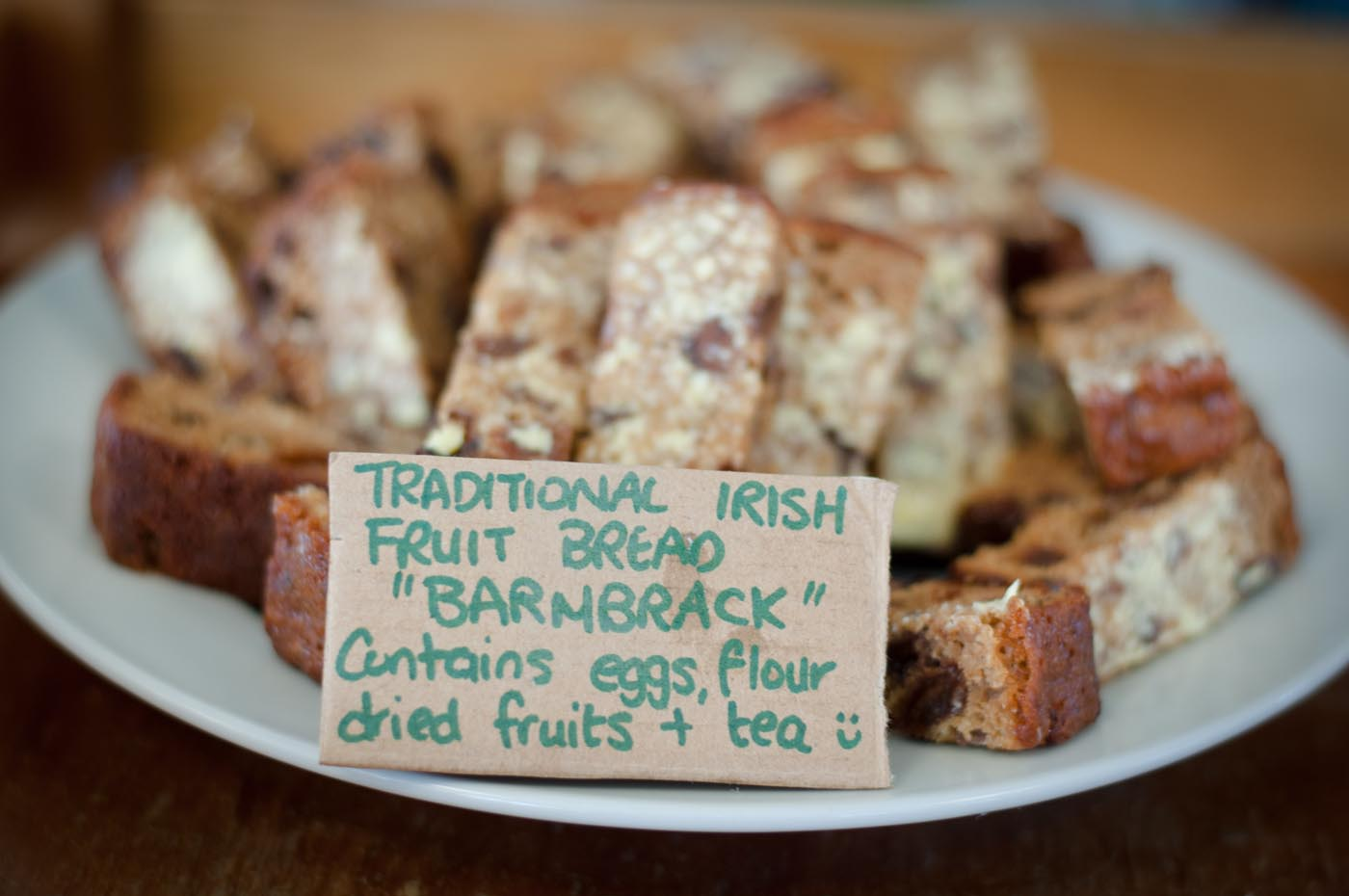 Photo showing a plate of traditional Irish fruit bread or Barmbrack with a sign listing the ingredients at the front - click to view larger image