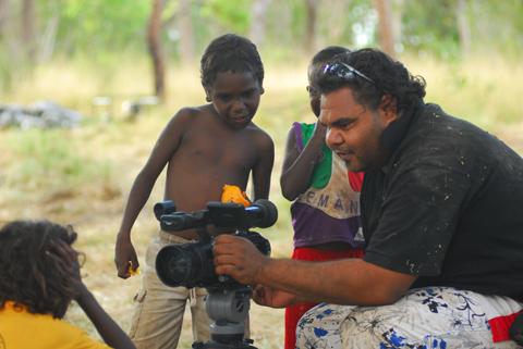 Filmmaker Clint Dixon introducing the camera to kids at Ngumpan, near Fitzroy Crossing. - click to view larger image