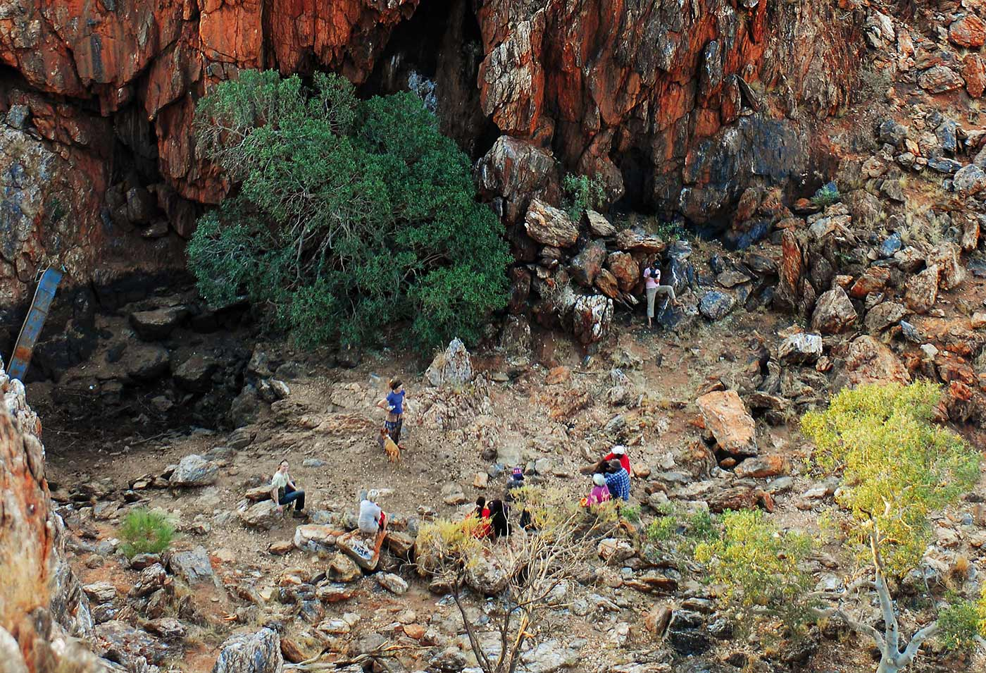 Aerial view of people relaxing amongst rocky terrain.