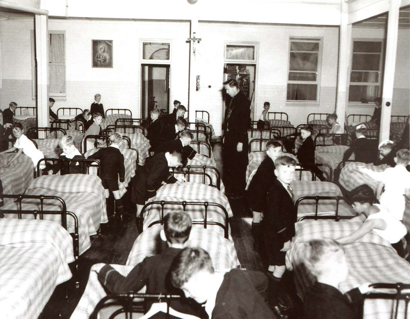 Photo of Brother Murphy in a dormitory at Castledare Boys' Home, Cannington, Western Australia. - click to view larger image