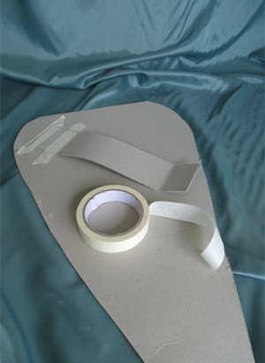 An example of how to attach a handle to the back of a shield.