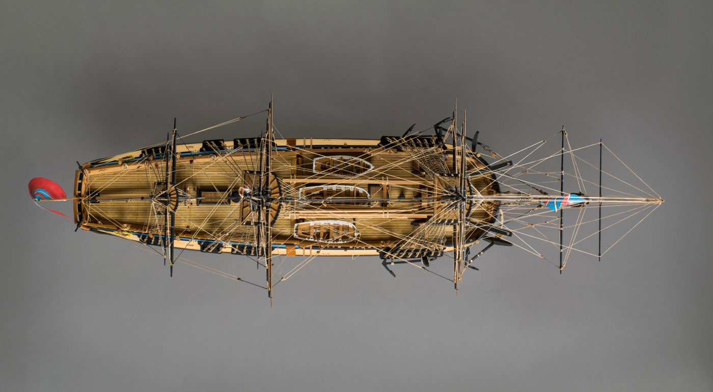 Image of a model wooden sailing ship, taken from above. - click to view larger image