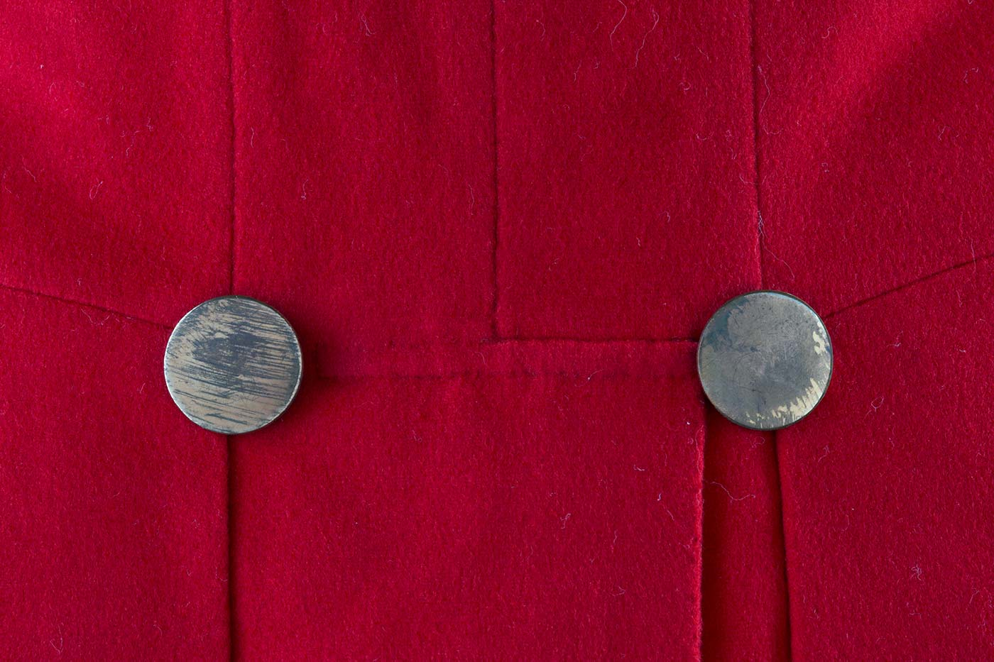Details of buttons on a red coat. - click to view larger image
