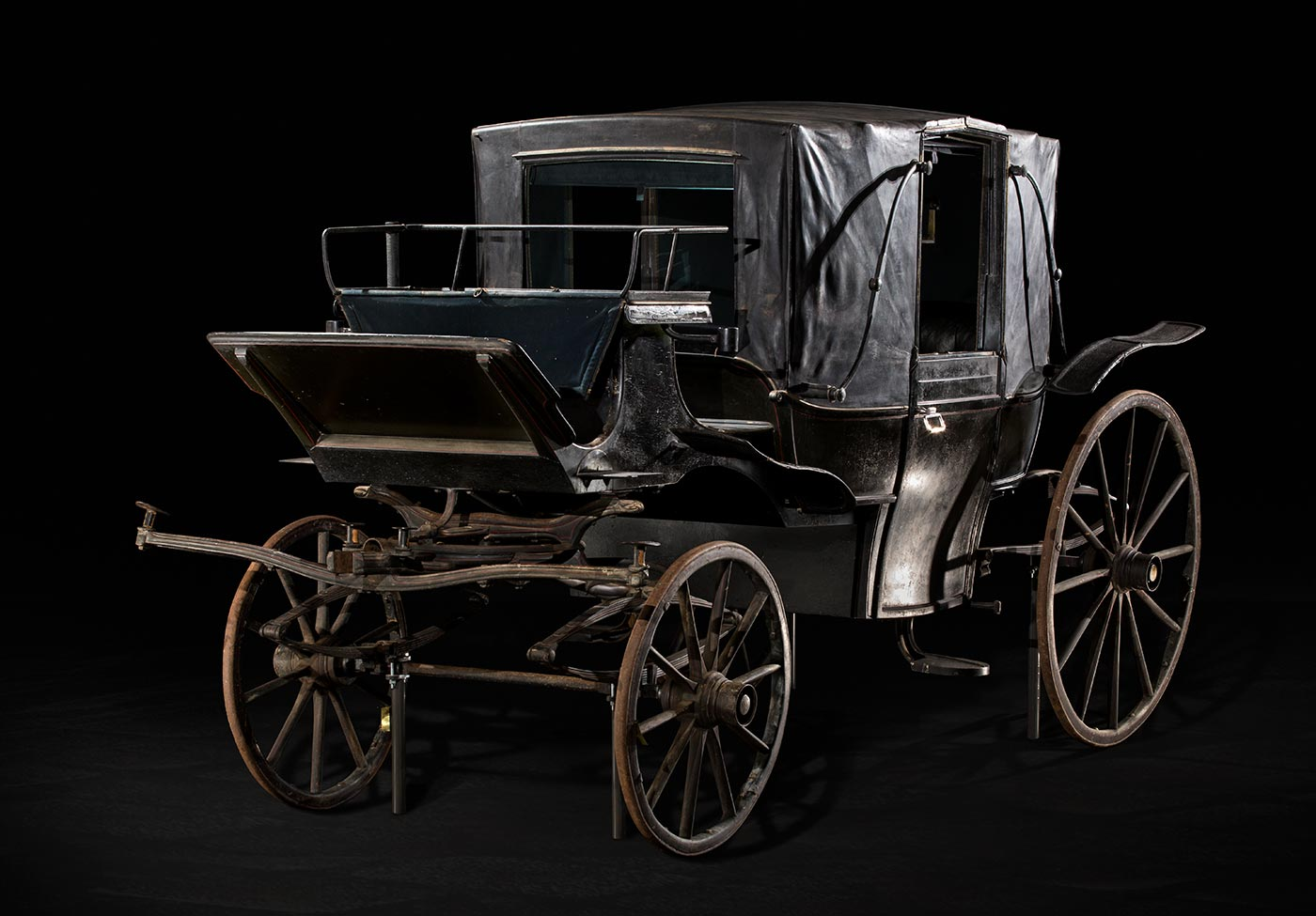 A carriage photographed in a studio.