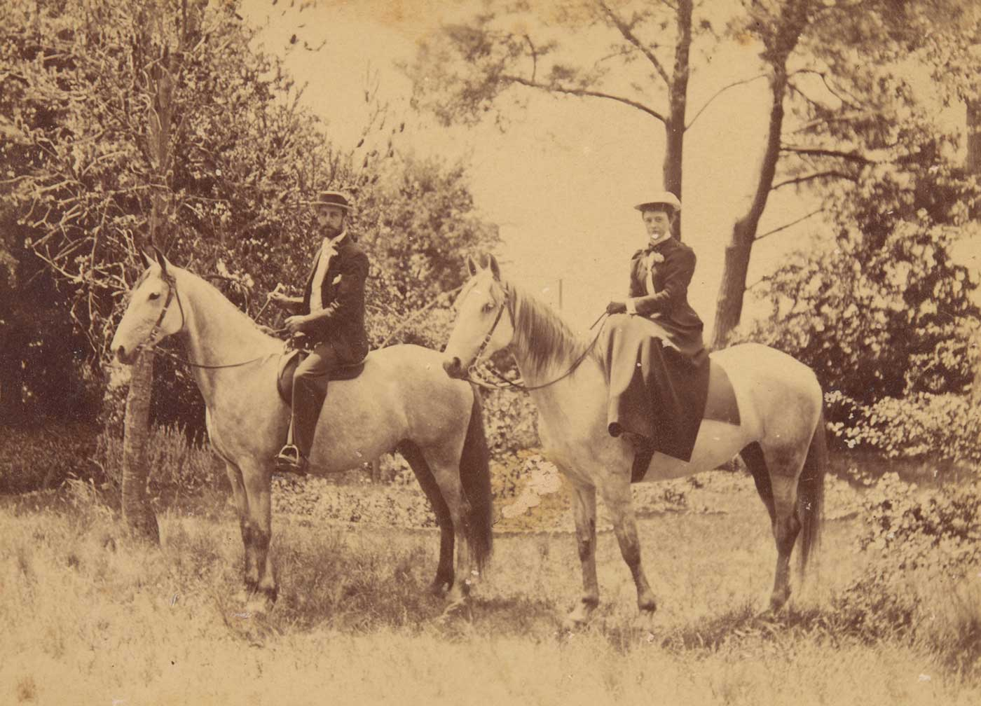 A black and white photograph that depicts William Hugh Anderson and Frances Lilian Faithfull mounted on light-coloured horses.