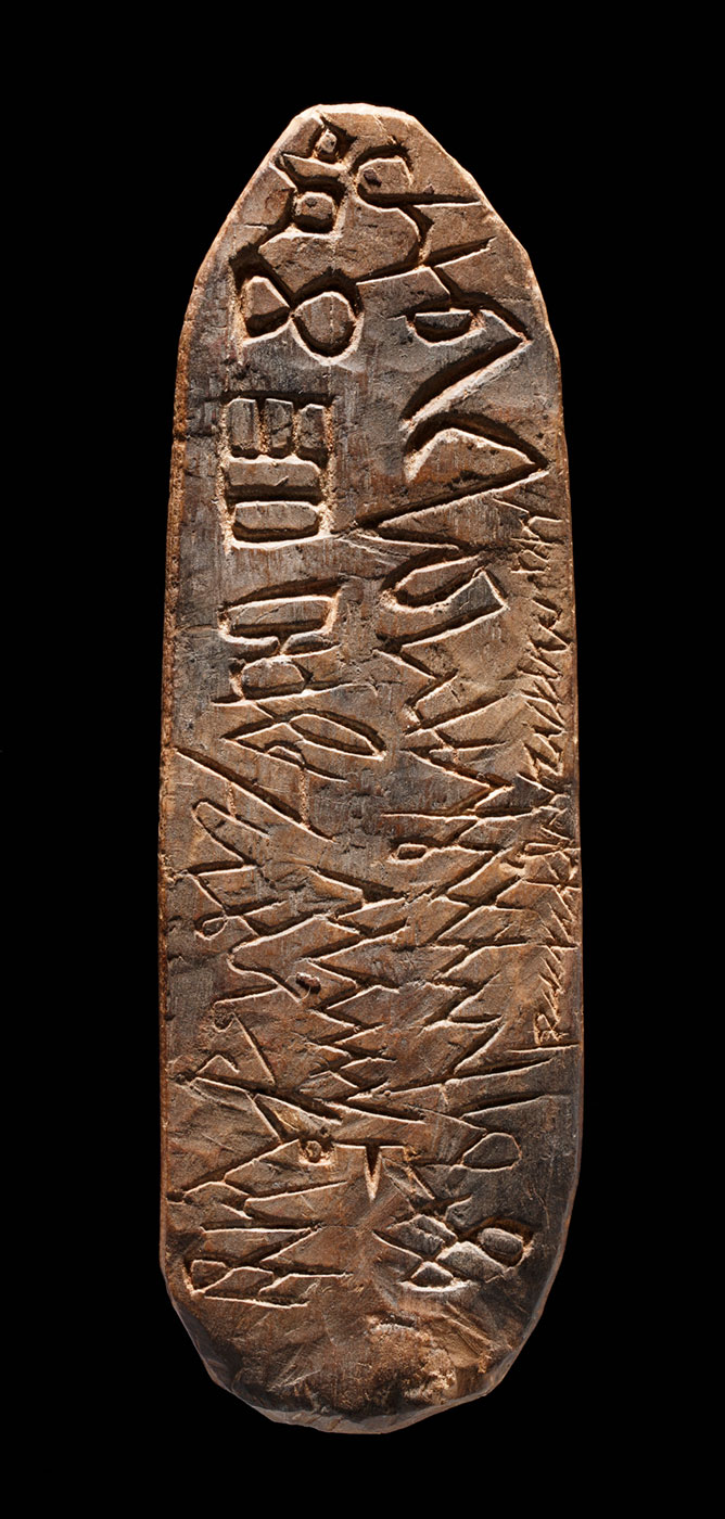 Piece of wood inscribed with patterns - click to view larger image