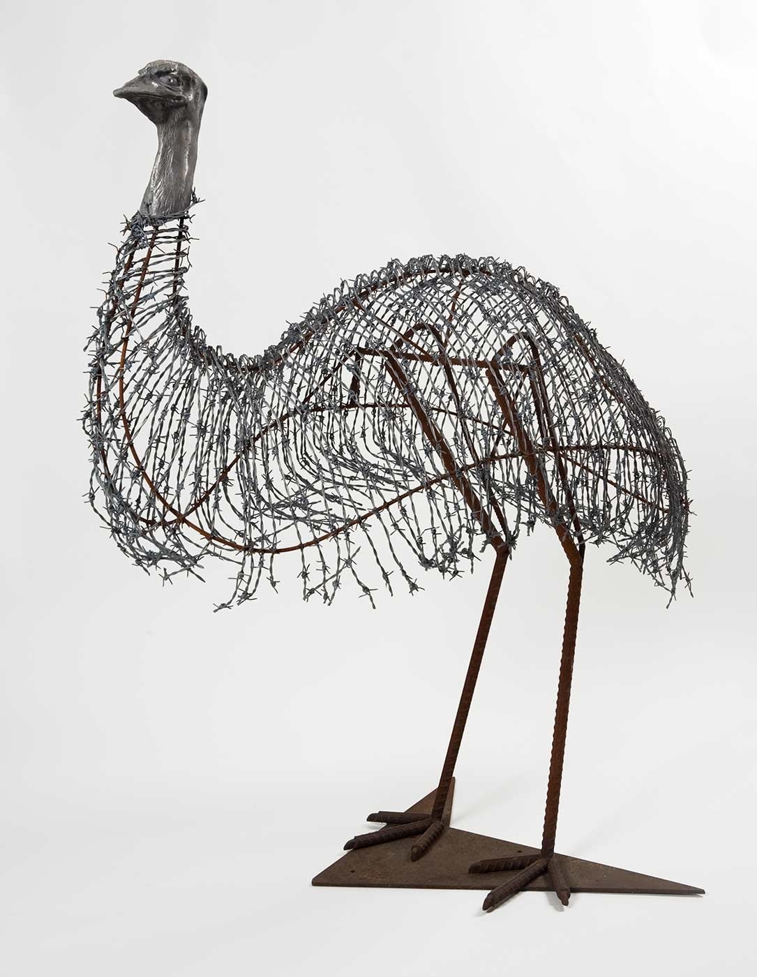 Sculpture of an emu fabricated from found objects including barbed wire and iron rods. - click to view larger image
