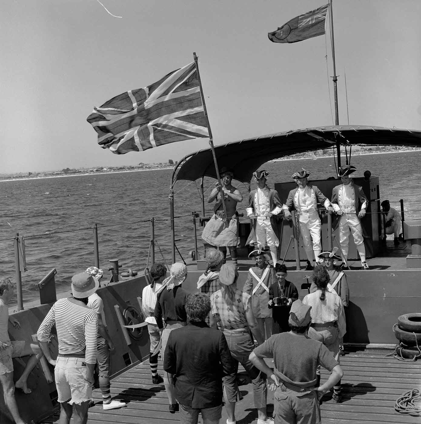 Black and white photo featuring people in a re-enactment of Captain Cook landing at Rockingham, March 1970 - click to view larger image