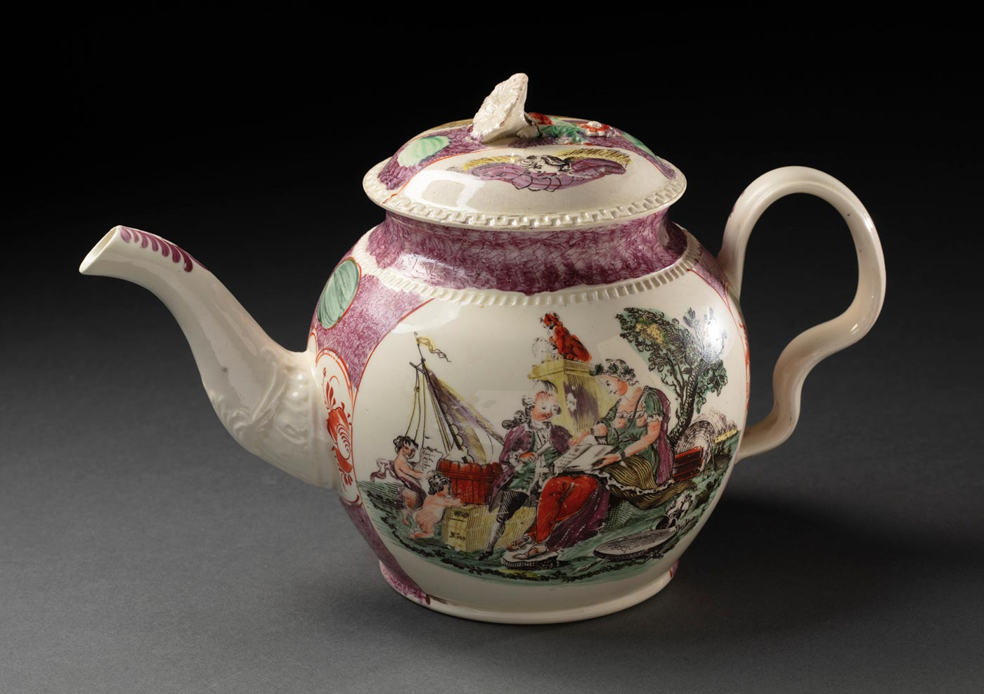 A creamware pottery teapot with a painted colour design. The pot has a spherical shaped body, a curved tapering spout, an ear-shaped handle, and a decorative lift off lid. The design has a voyage theme, showing an main oval panel featuring a woman and man - identified as Britannia directing Captain James Cook - in a seascape background. The lid is also painted and has a floral form handle. The juncture of the handle and lid is damaged. - click to view larger image
