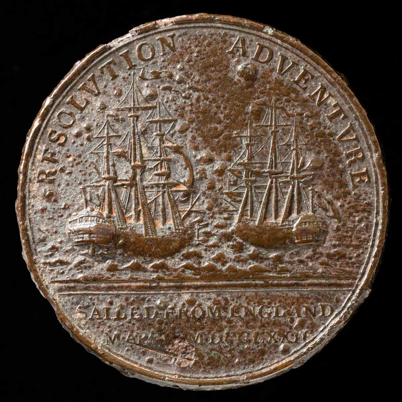 A medal featuring two ships from Cook's second voyage, showing the sloops at sea, with the text 'RESOLUTION ADVENTURE' above. Further details below the ships read 'SAILED FROM ENGLAND / MARCH MDCCLXXII'.  - click to view larger image