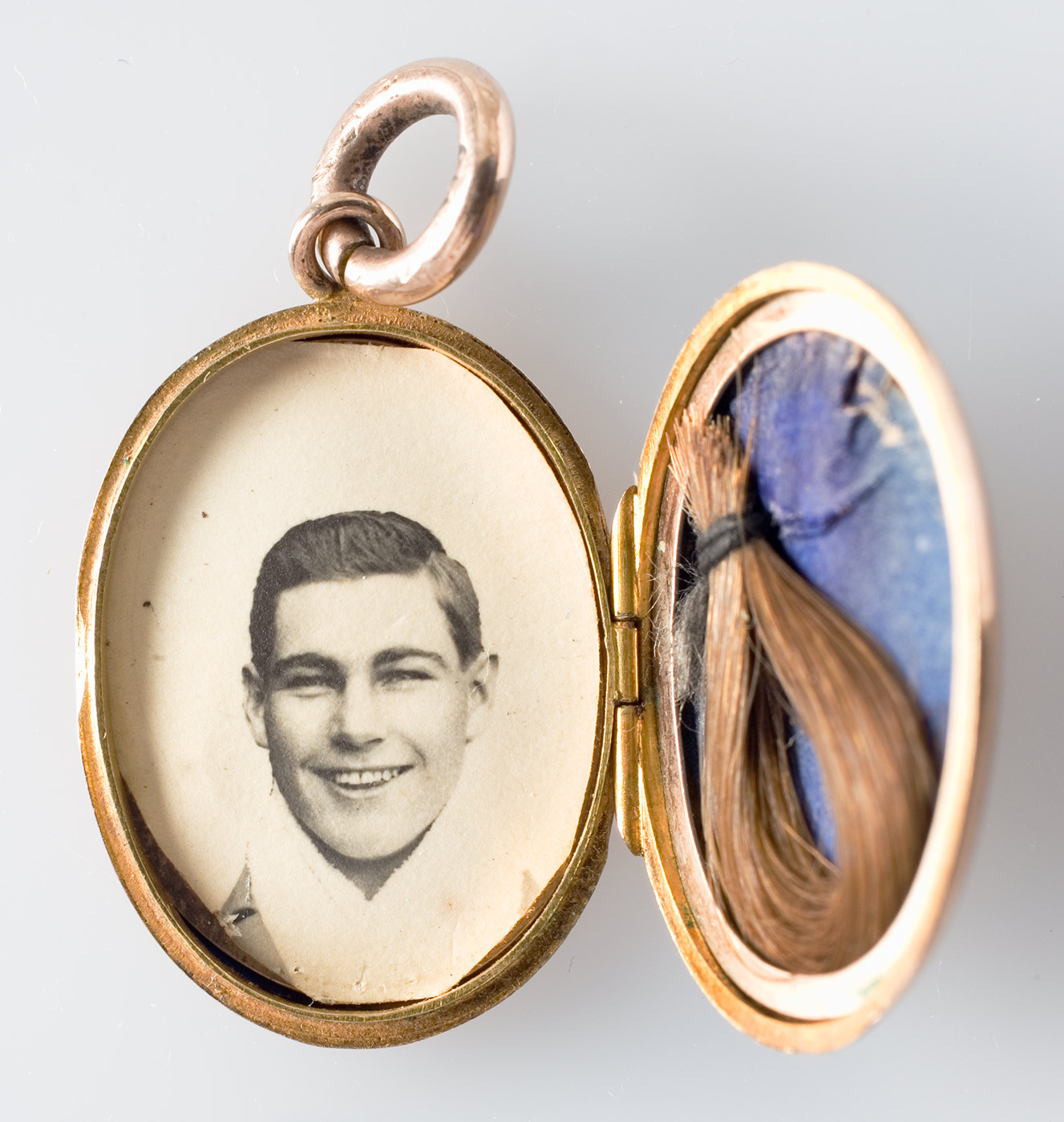 Images of the mourning locket, open and revealing a photo of Les Darcy (on left) and a lock of his hair on a blue background (on right).