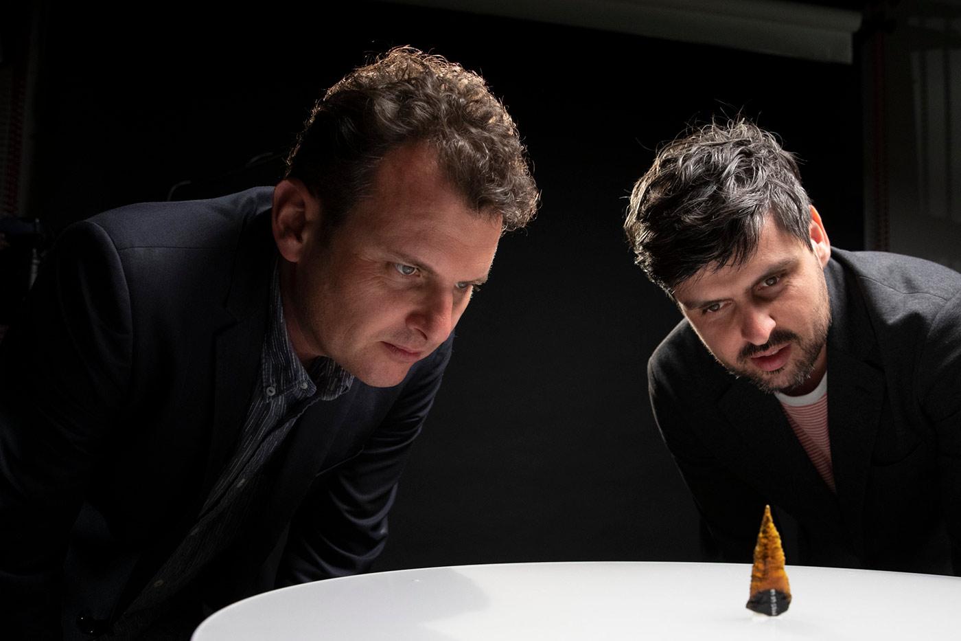 Slava and Leonard Grigoryan inspect an arrow point with an amber coloured head.