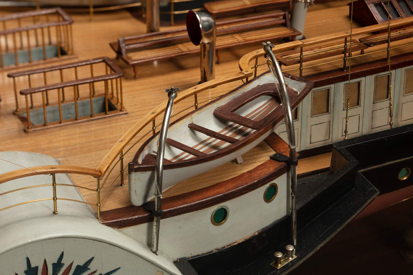 Detail of a model of a ship featuring a life boat. - click to view larger image