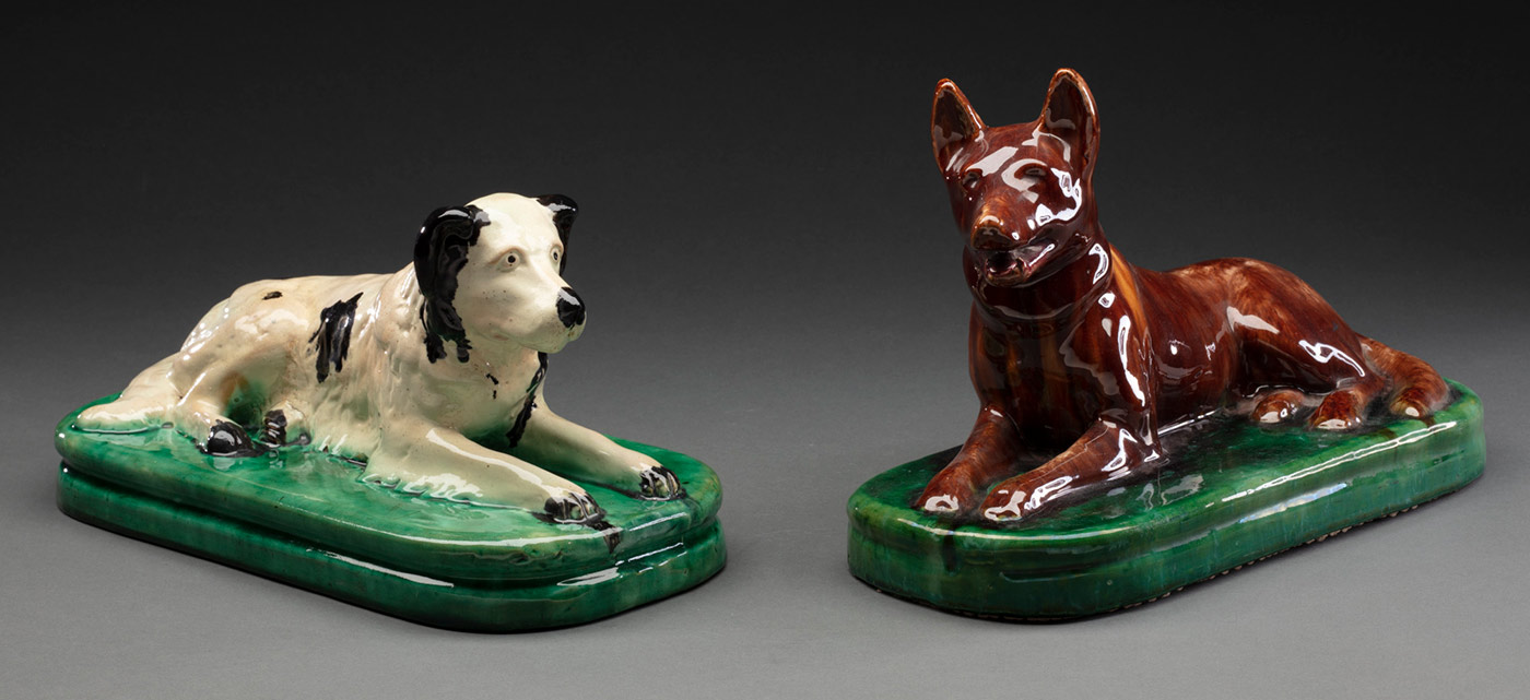 Two painted ceramic door stops in the form of a labrador retriever and a kelpie. - click to view larger image