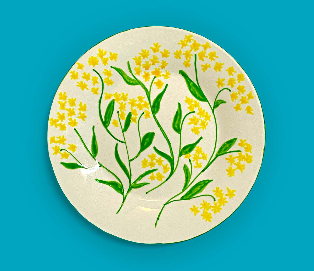 Ceramic plate featuring a hand-painted wattle design. - click to view larger image