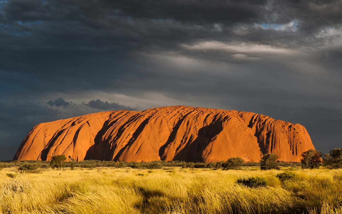 Panorama of Uluru against a dark sky. - click to view larger image