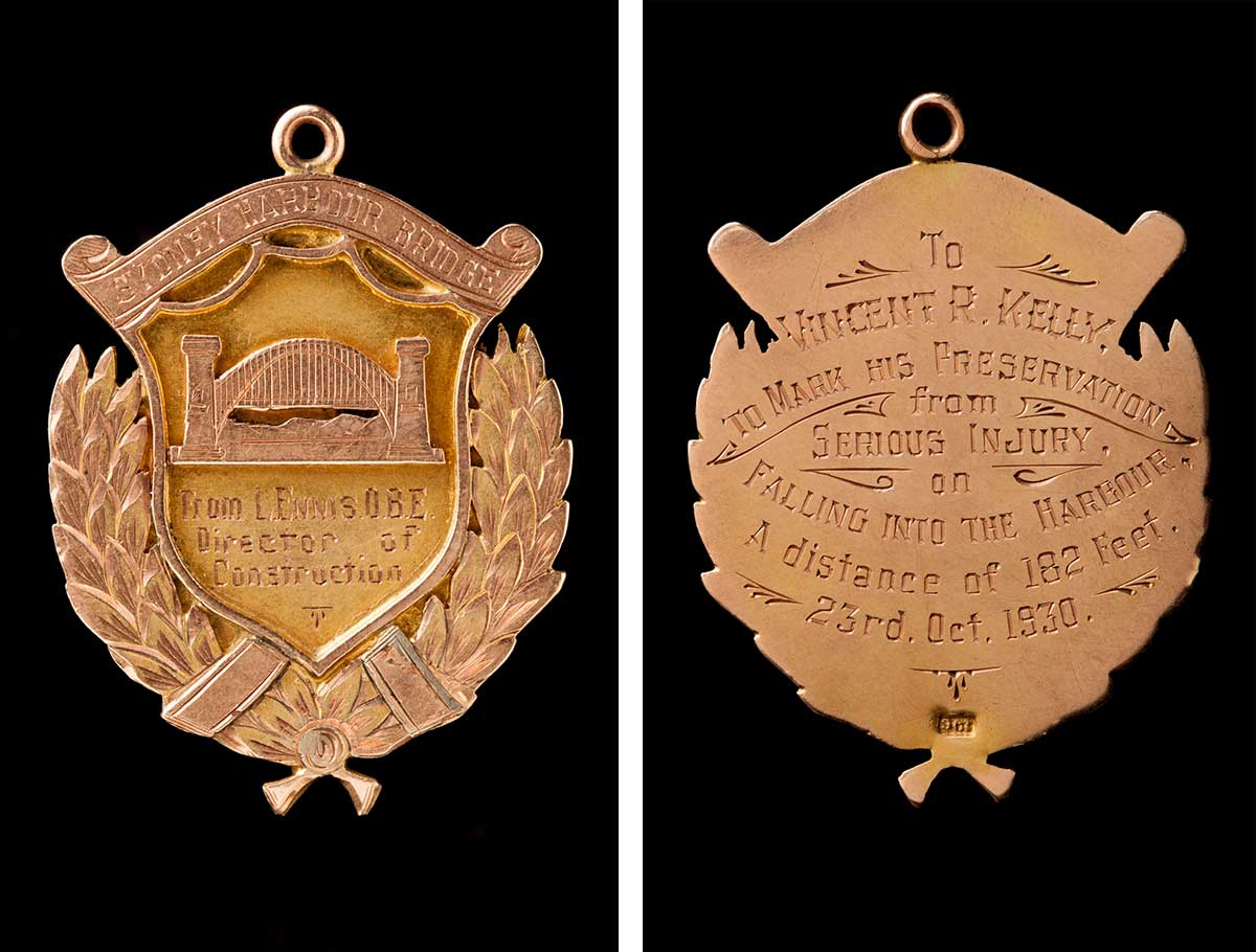 The front and back of a medal awarded to Vincent Kelly.  The front has an image of the Sydney Harbour Bridge with an inscription that reads: 'From L. Ennis. O.B.E. Director of Construction'. The inscription on the back reads: 'To Vincent R. Kelly. To mark his preservation from serious injury on falling into the harbour. A distance of 182 feet. 23rd. Oct. 1930.' - click to view larger image