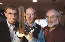 (left to right) Curator Dr Mike Smith; inaugural Museum research fellow, Julian Holland and curator Denis Shephard with a circumferentor used from the 1860s.