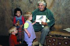 Storyteller June Barker from Lightning Ridge entertains children in the Museum's boab tree