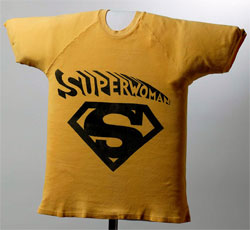 Yellow T-shirt with a large Superwoman icon on the front