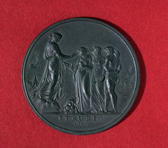 Dark grey circular medallion with four classical figures in relief, above 'ETRURIA, 1789'.