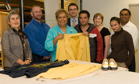 Museum staff and Jackie Huggins with her jacket, blouse, shoes and earrings.