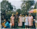 Five women and a man posing for photos at a backyard party. From Williams family photo album.