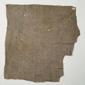 Thin two-layered barkcloth with a grey colour. It has perforations derived from the beating process.